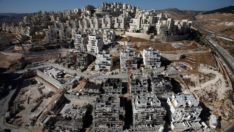 Houses under construction are seen in a Jewish settlement near Jerusalem known to Israelis as Har Homa and to Palestinians as Jabal Abu Ghneim [Baz Ratner/Reuters]