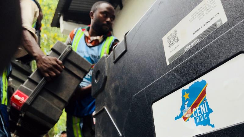 Employees of Congo's Independent National Electoral Commission deliver voting machines and materials to a polling station [Jackson Njehia/Reuters]