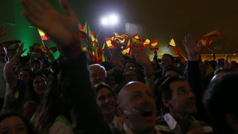 Supporters of Vox party celebrate the regional election results in Seville [Marcelo Del Pozo/Reuters]