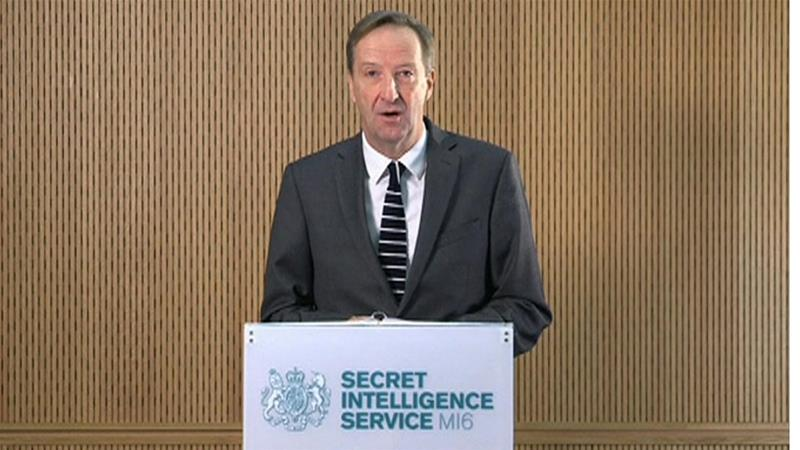 MI6 chief Alex Younger speaks at MI6's Vauxhall Cross headquarters in central London [Reuters]