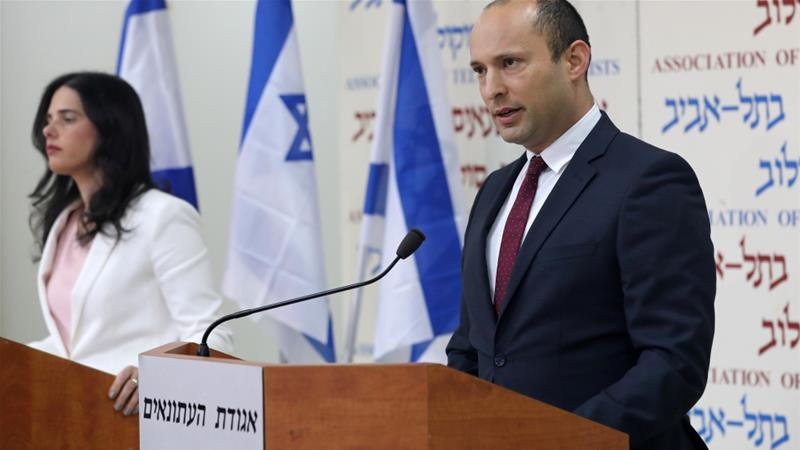 Israeli Education Minister Naftali Bennett (R) and Justice Minister Ayelet Shaked deliver statements in Tel Aviv [Corinna Kern/Reuters]