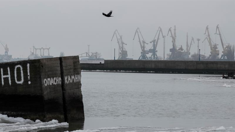 The port city of Mariupol, located on the Sea of Azov, heavily relies on ships coming through the Kerch Strait [Gleb Garanich/Reuters]