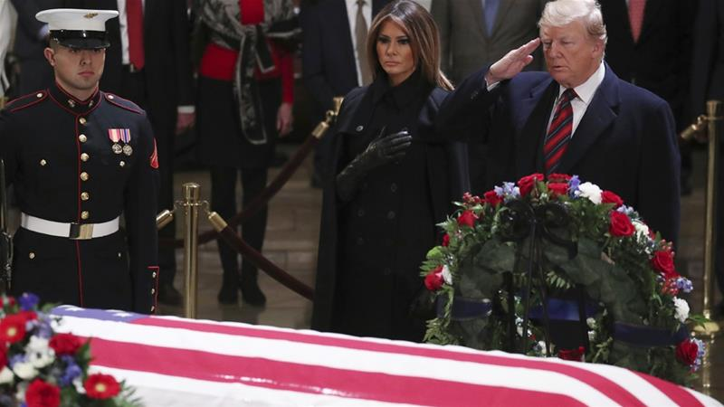 Trump has declared Wednesday a national day of mourning in honour of the 41st president [Jonathan Ernst/AP]