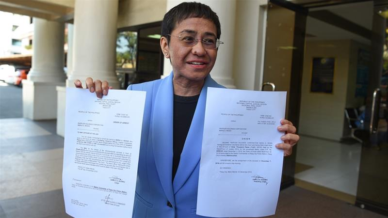 The arraignment of one of the tax evasion cases against Ressa and Rappler is set on Friday [Ted Aljibe/AFP]