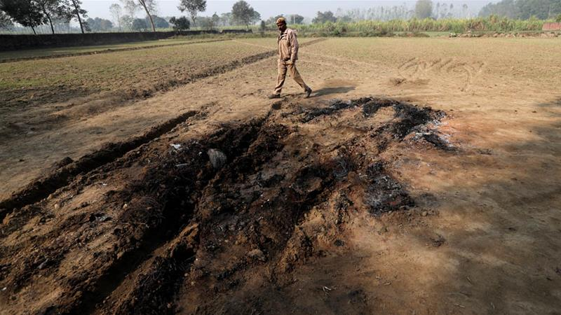 A police officer walks next to the spot where Singh was killed by a mob in Bulandshahr [Adnan Abidi/Reuters]