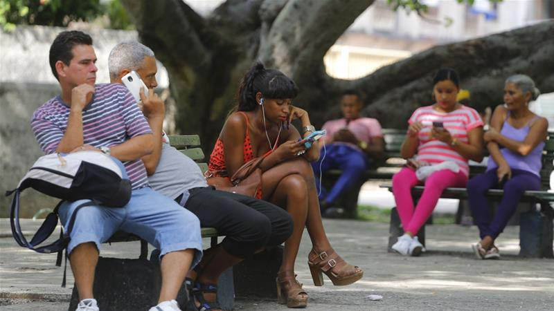 Outdoor wi-fi hotspots are popular in Cuba but often overcrowded and with slow connections [File: Desmond Boylan/AP Photo]