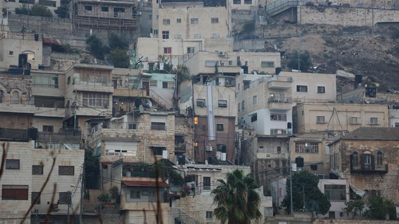 Israeli flags on buildings mark settlers' presence in Batan al-Hawa, occupied East Jerusalem [Mersiha Gadzo/Al Jazeera]