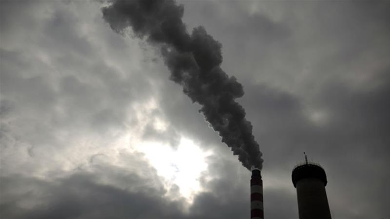 Chinese power producers are building coal-fired plants not only at home, but increasingly abroad as well. According to the Global Coal Exit List, 24 percent of China's new coal power generating capacity will be built in 20 other countries [File: Mark Schiefelbein/AP]