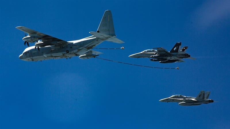 File photo from the US Marine shows two F/A-18 jets in a refueling exercise with a KC-130 aircraft [US Marine/AP]