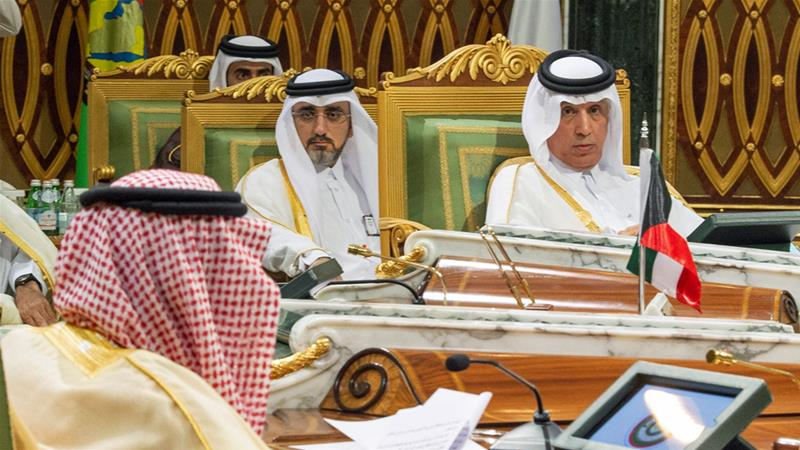 Qatar's Minister of State for Foreign Affairs Soltan bin Saad Al-Muraikhi (right) listens as King Salman speaks on Sunday [Bandar Algaloud/Saudi Royal Court via Reuters]