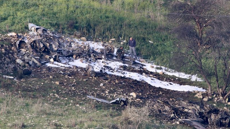 The remains of an F-16 Israeli warplane are seen near the Israeli village of Harduf, Israel on February 10, 2018 [Herzie Shapira/Reuters]