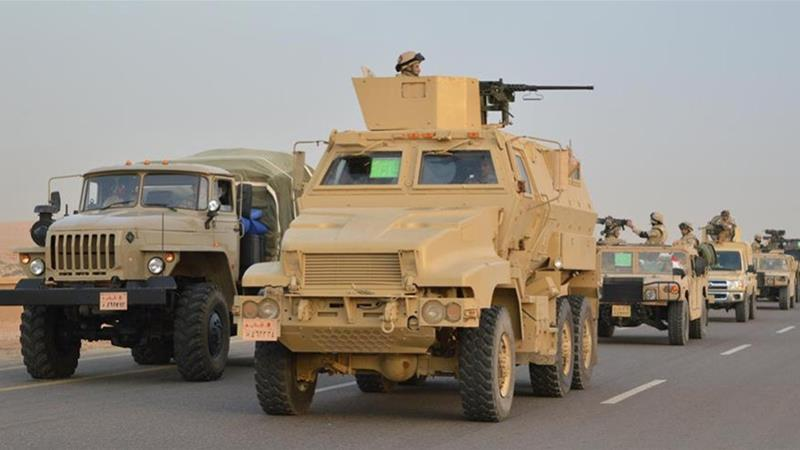 Egyptian military vehicles drive down a highway towards North Sinai on Friday [Egyptian Ministry of Defence/Reuters]