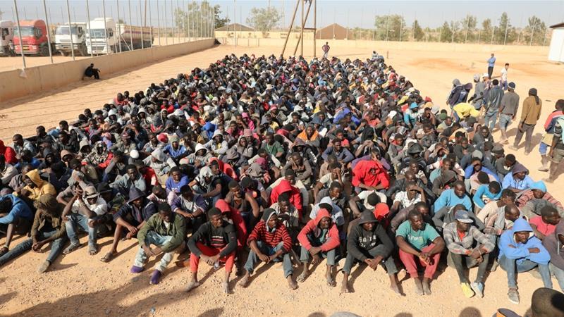 Migrants sit at a detention centre in Gharyan, Libya [Hani Amara/Reuters]