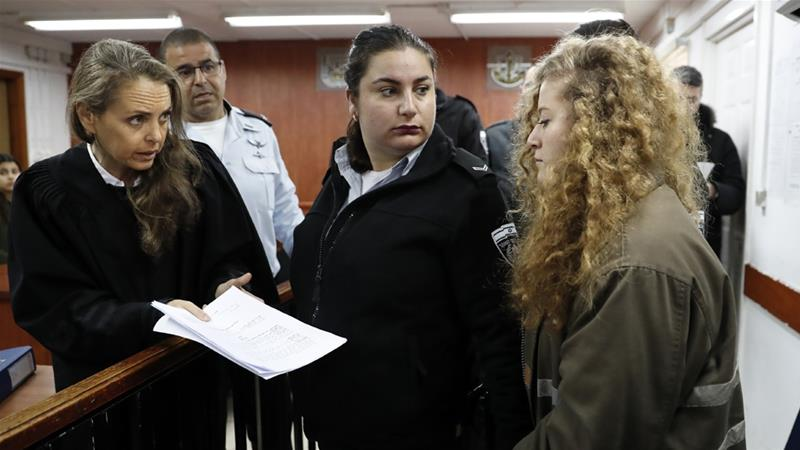 Ahed Tamimi is facing 12 charges, which could lead to her facing years in prison [AFP]