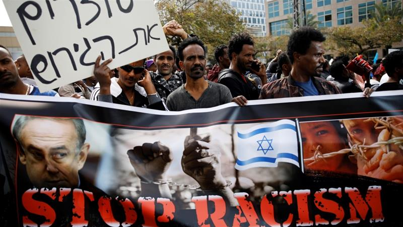 People protest against the Israeli government's plan to deport African asylum seekers, in front of the Rwandan embassy in Tel Aviv on February 7 [Reuters/Amir Cohen]
