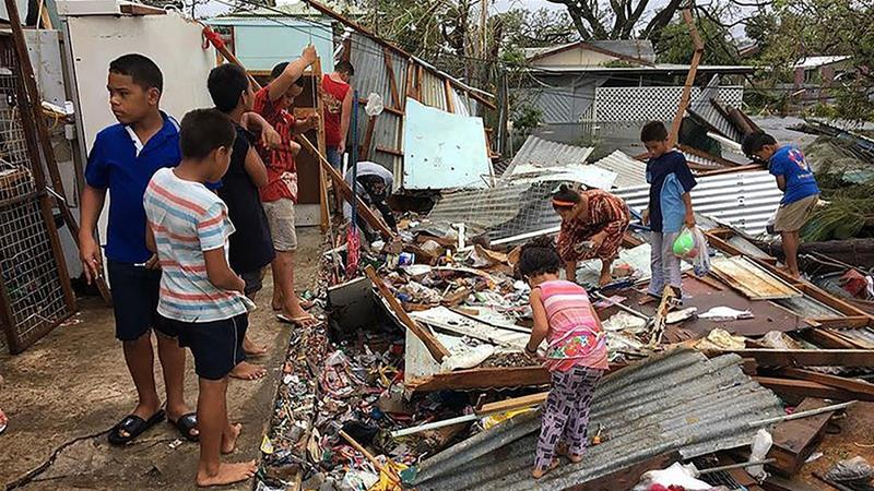 Shirtless flag bearer's family safe after cyclone devastates Tonga