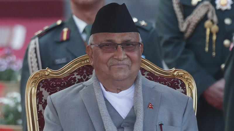 Prime Minister Khadga Prasad Oli smiles after taking the oath of office in Kathmandu on Thursday [Niranjan Shrestha/AP]