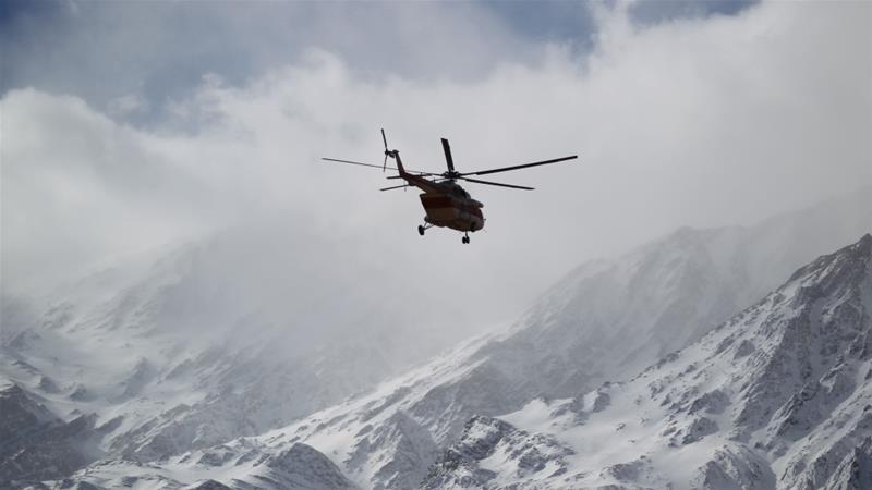 The search will continue on foot in the mountainous crash area, Iranian state TV said [Tasnim News Agency/Reuters]