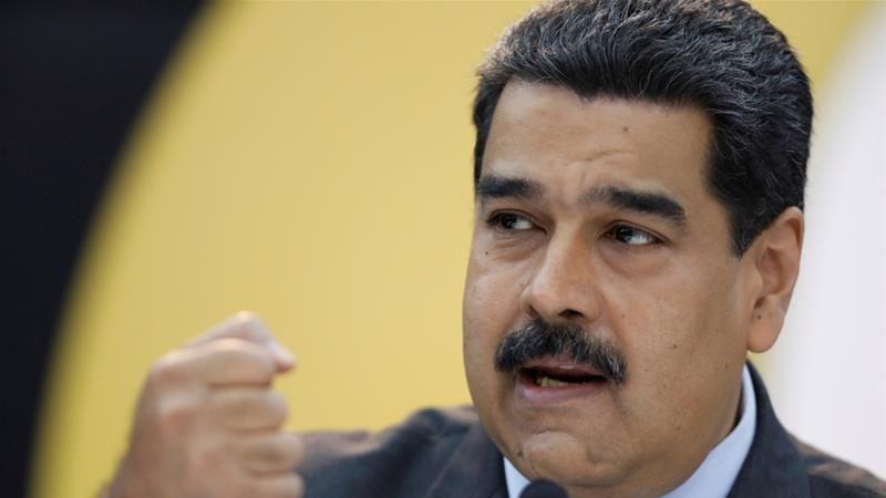Venezuela's President Nicolas Maduro has accused the opposition of siding with foreign powers [Marco Bello/Reuters]
