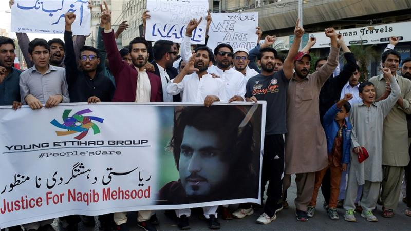 People chant slogans and hold signs as they condemn the killing of Naqeeb Mehsud, a 27-year-old aspiring Pashtun model, in Karachi [Akhtar Soomr/Reuters]