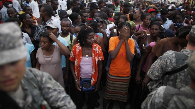 Haitians wait to get food coupons in downtown Port-au-Prince following the 2010 earthquake that wrecked much of Haiti's capital and killed as many as 200,000 people [Eliana Aponte/Reuters]