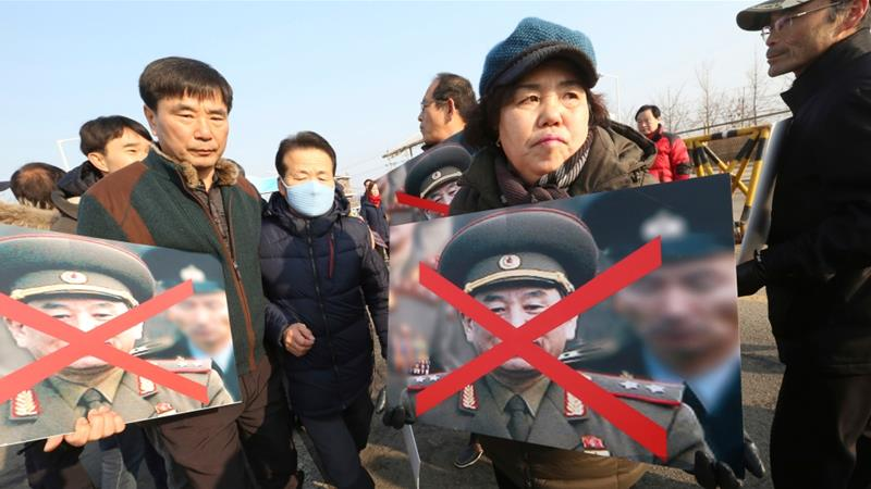 Activists protested against the arrival of North Korean official Kim Yong-Chol because of his alleged involvement in the sinking of a South Korean naval ship, which killed 46 sailors [Ahn Young-joon/The Associated Press]