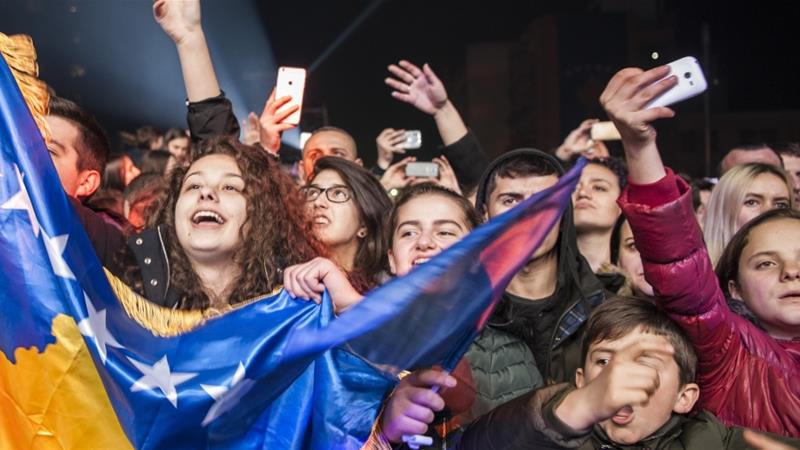 The Kosovo flag is waved during a concert by Rita Ora in Pristina on February 17, on the occasion of the 10th anniversary of Kosovo Independence [Armend Nimani/AFP]