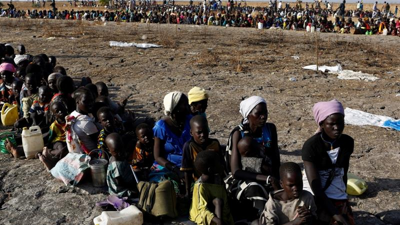 Women and children wait for food distribution by the United Nation World Food Programme [Photo/Siegfried Modola/Reuters]