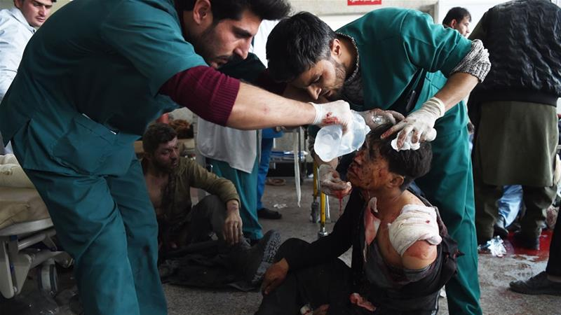 Afghan medical staff treat a wounded man after a car bomb exploded in Kabul in the Taliban-claimed January attack [File: Wakil Kohsar/AFP]