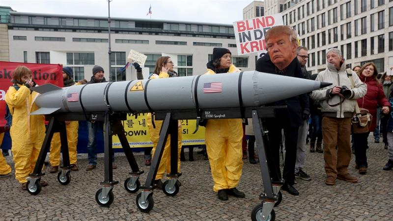 Activist with a mask of Donald Trump in a demonstration against nuclear weapons, November 18, 2017, Berlin [Photo/Adam Berry/Getty Images]