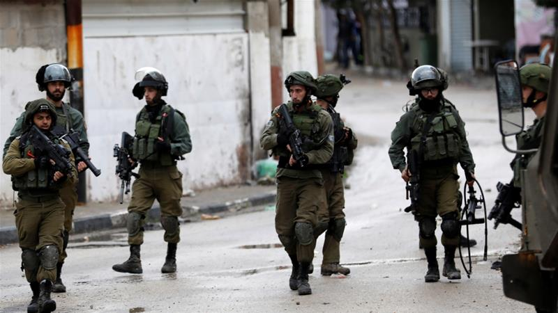 Israeli forces raided the village of Wadi Burqin in the occupied West Bank on Saturday night [Mohamad Torokman/Reuters]