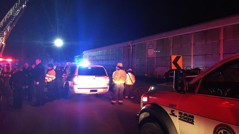 Emergency responders work at the scene of a crash between an Amtrak passenger train and a CSX freight train [Lexington County Sheriff's Department/The Associated Press]