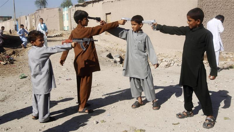 Afghan boys play with toy guns on the first day of Eid al-Adha in Jalalabad, Afghanistan [Parwiz/Reuters]