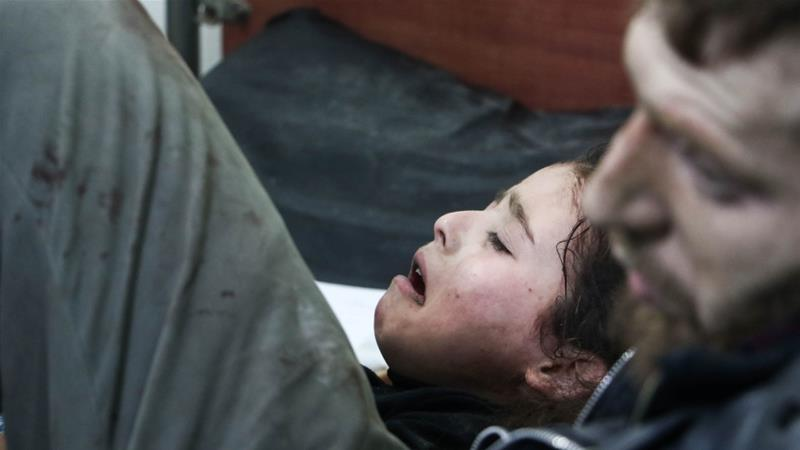 A Syrian girl lies on a stretcher at a hospital after air raids targeted her hometown of Arbin in Eastern Ghouta on February 06 [Anadolu/Diaa Al Din]