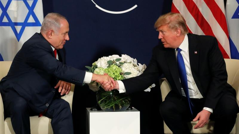 US President Donald Trump shakes hands with Israeli Prime Minister Benjamin Netanyahu during the World Economic Forum's meeting in Davos on January 25 [Reuters/Carlos Barria]