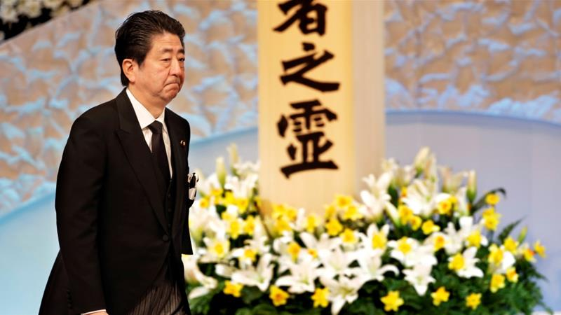 Japan tsunami anniversary: PM Shinzo Abe pledges to rebuild