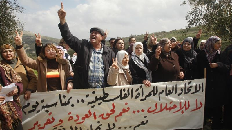 "Demonstration to mark International Women's Day in the West Bank village of Burin near Nablus, March 8, 2011. The banner reads, in Arabic: ""The General Union of Palestinian Women marks Women's Day. No to occupation. Yes to the right of return (for refugees). Yes to unity."" REUTERS/Abed Omar Qusini [Reuters]"
