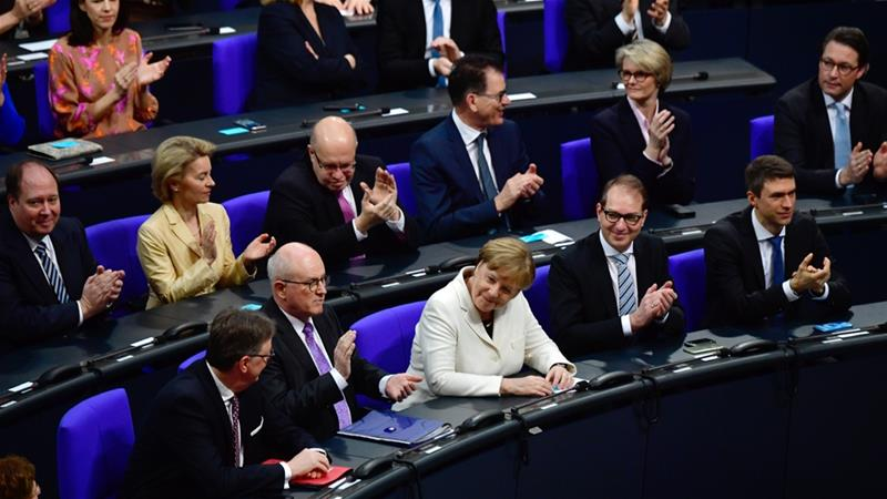 Germany coalition deal: Merkel takes power after difficult talks