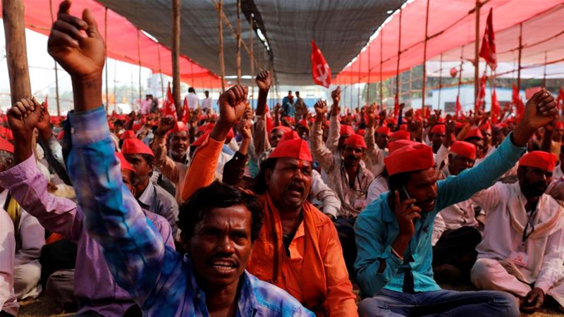 Farmers shout slogans against the government at a rally in Mumbai [Danish Siddiqui/Reuters]