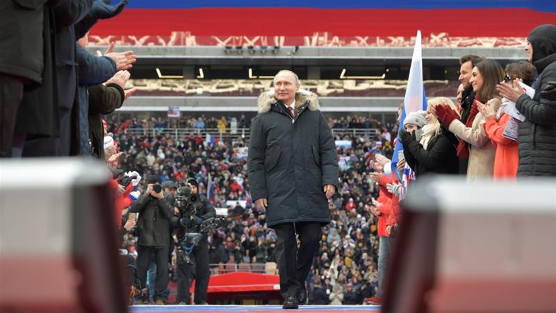 Russian President Vladimir Putin arrives to take part in a rally to support his bid in the upcoming presidential election, at Luzhniki Stadium in Moscow on March 3 [Reuters]