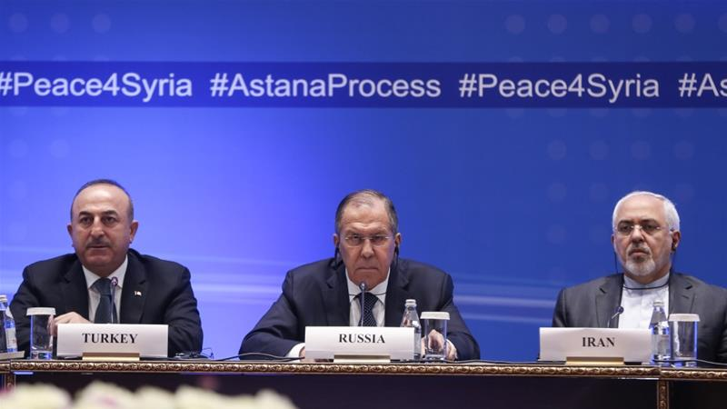 Turkish Foreign Affairs Minister Mevlut Cavusoglu (L), Russian Foreign Minister Sergey Lavrov (C) and Iranian Foreign Minister Mohammad Javad Zarif (R) hold joint press conference after the ninth round of Syria peace talks in Astana, Kazakhstan on March 16, 2018 [Anadolu]