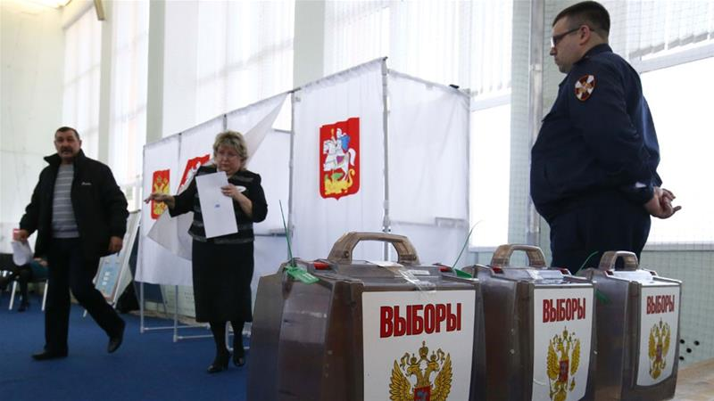 Close to 109 million registered voters will have the right to cast their ballot in Sunday's poll [Sergei Karpukhin/Reuters]