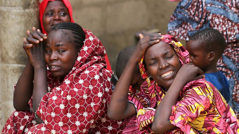 Relatives of missing schoolgirls react in Dapchi, in northeastern Yobe state, after February's mass abduction [Afolabi Sotunde/Reuters]