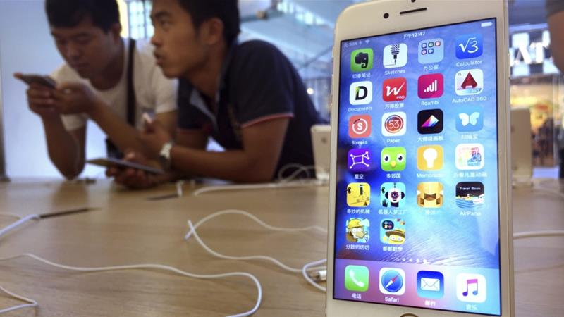 Apple Inc's iPhones are assembled in China and count as a Chinese export to the United States [File: Mark Schiefelbein/AP Photo]