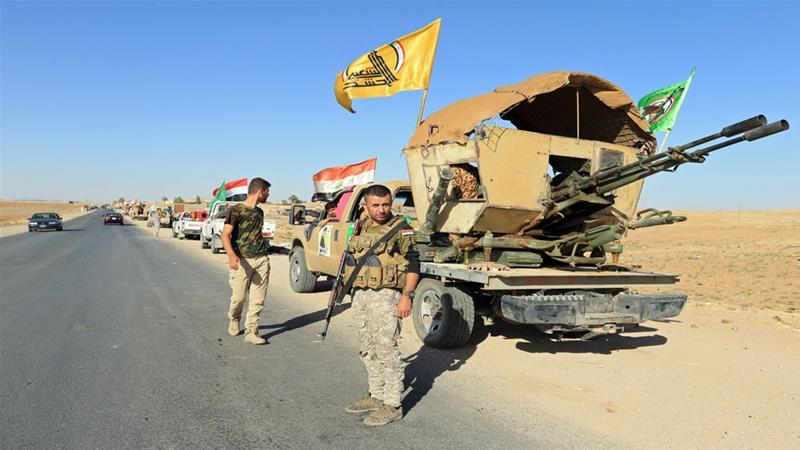 Popular Mobilisation Forces (PMF) are seen in Zumar in Iraq's Nineveh province [File: Reuters]