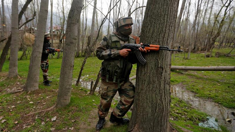 Indian soldiers take positions near the site of a firefight near Srinagar last Thursday [Danish Ismail/Reuters]