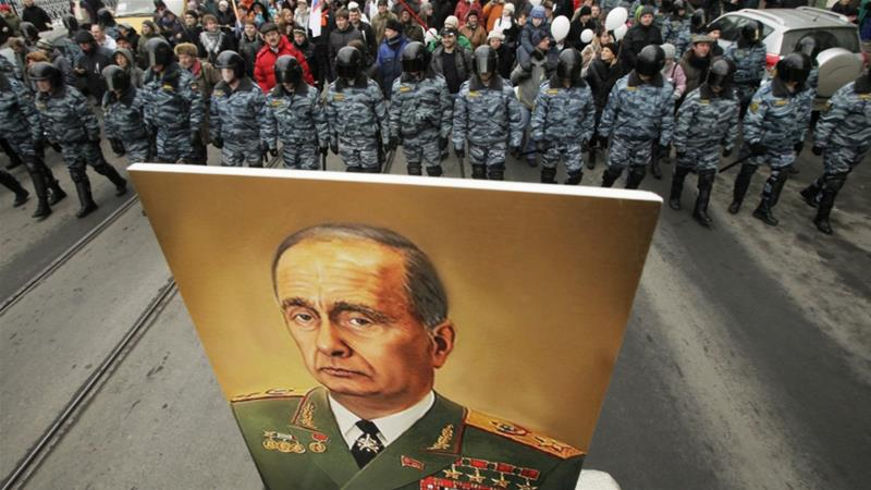 Demonstrators carry a poster depicting Vladimir Putin as the late communist leader Leonid Brezhnev, during a massive protest rally in St Petersburg on February 25, 2012 [File photo: AP/Dmitry Lovetsky]