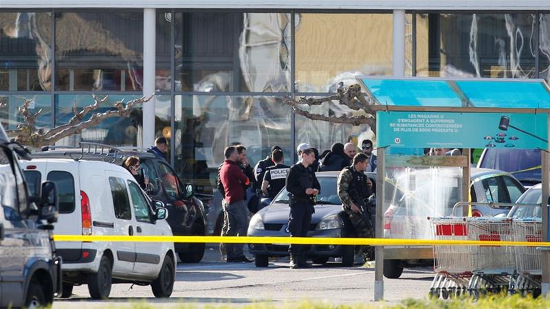 Police officers secured a supermarket after a hostage situation in Trebes [Regis Duvignau/Reuters]
