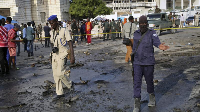 Security forces at the scene of a car bomb explosion near parliament in Mogadishu on Sunday [Mohamed Sheikh Nor/AP]