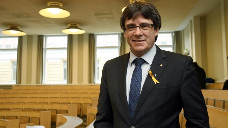 Catalan parliament acts to allow absent candidate to be voted leader